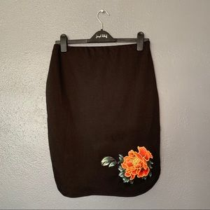 Black skirt with flower